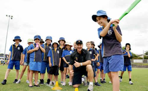 Gympie South State Primary School's Chantelle Chippindall with Andy Bichel in the background at Albert Park.