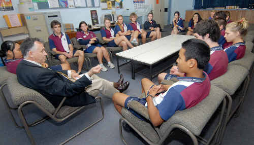 Speaker of the Queensland Parliament, John Mickel, discusses the planned Mackay sitting of Parliament next May with Mackay State High School Year 11 students yesterday.