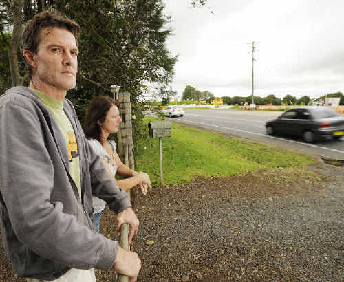 Short-changed: Wayne Corney and his wife Leeanne are angry that the RTA has failed to act on requests that a sound mitigation barrier on the Alstonville bypass be extended to protect their Wollongbar home.