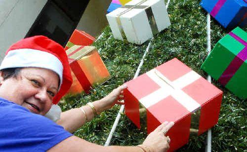 Mackay regional councillor Karen May decorates the council Christmas tree.