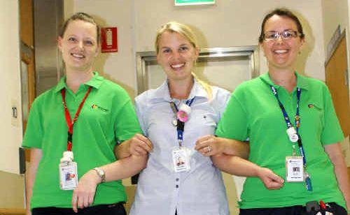 Mackay Base Hospital nurses, from left, Samara Grace, Hannah Marx and Kym West prepare for Health Week.