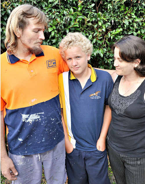 John-Paul and Kylie Andrew with their son Zac. They say an ambulance should have been called when he lost consciousness at school.