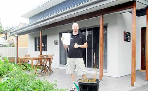Ben Luffman, the owner of Toormina's Nangara Eco House shows off his latest 'in-credit' power bill.