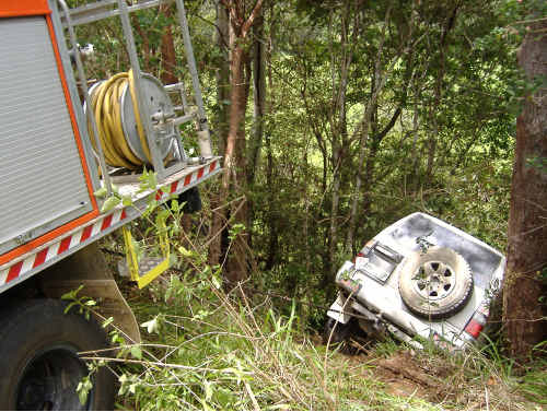 The 4WD was chained to a fire truck to prevent it from going down the embankment.