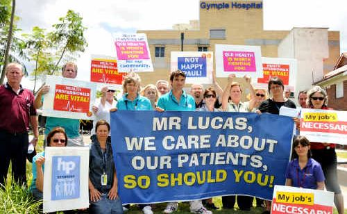 Queensland health workers rally together yesterday to stand up against wage cuts and for improved health services and health resources for their community.