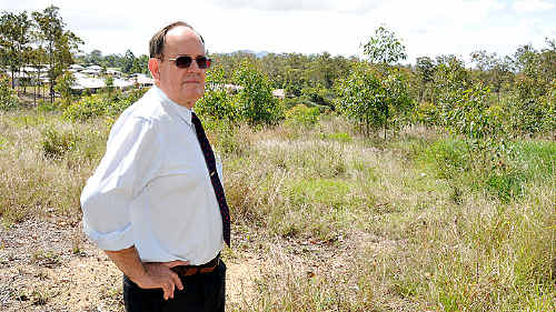 Councillor Ian Petersen at the site of a proposed intensive multi-residential development which will go ahead after ratification yesterday. He said a refusal would have been costly and impossible to defend.