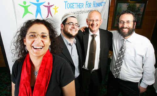 Diversity workshop leaders (from left) Ronit Baras, Sheik Ahmad Abu Ghazaleh, MP Shayne Neumann and Rabbi Zalman Kastel stand together for humanity.
