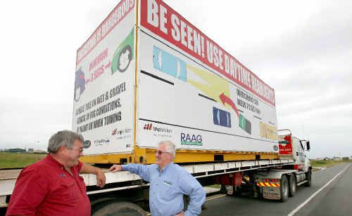 Peter Lewis of PK's Truckwise and Graeme Ransley of RAAG, with a truck that will be carrying safety messages around to promote road safety.