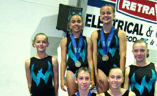 Mackay gymnasts, from back left, Merinda Bathe, Claudia De Luca, Rebecca Wootton, Tyler Johnson, Olivia Abell, Kelly Vincent, Alyse Bohne and Alyssa Collins competed in the NQ Games at Cairns earlier this year.