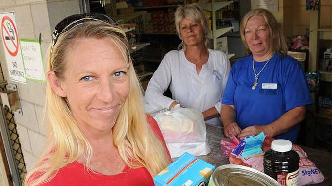 Krista O'Neile picks up a few essentials from Gympie's Foodbank. The mother of four says despite her husband working, they are struggling to make ends meet