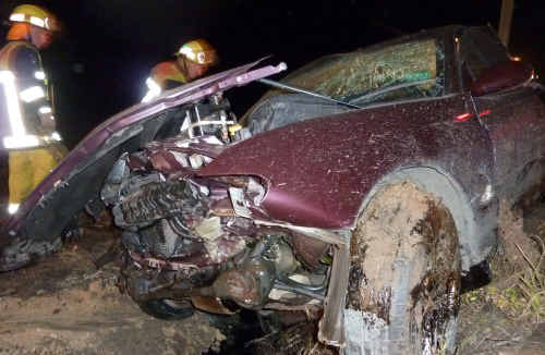 Wild ride: After hitting a fuel tanker and sugar cane harvester, this car eventually landed in a paddock.