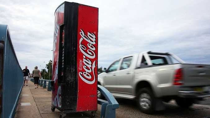 Pranksters left a fizzy surprise for motorists and walkers at Coffs Harbour after this vending machine was stolen and wheeled onto a bridge.