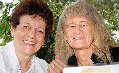 Hervey Bay's Bev Cornwell and Maryborough's Joan Darlington caught up and shared memories and photos at Point Vernon.