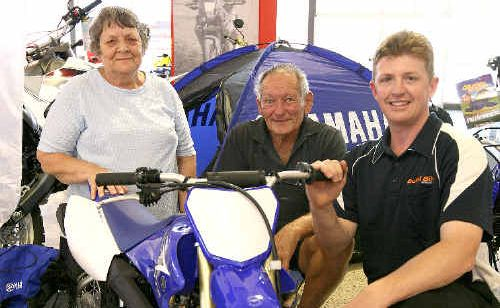 Ada and Douglas Jones meet with Bullet Bikes dealer principal Jason Kocass to accept the prize they won in the Daily Mercury Bullet Bikes promotion.