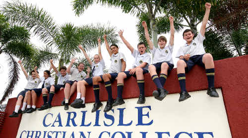 Carlisle Christian College students, from left, Hanna Rolls, Gabrielle Holmes, Jordan Davies, Taylor Verney, Adrienne Hormann, Joffre Bobongie, Trace Berardi, Sam Brookfield and Jesse Wilson are ecstatic their school will remain open.