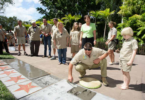Steve Irwin's son Robert puts an impression of his hands and feet in concrete at Australia Zoo.