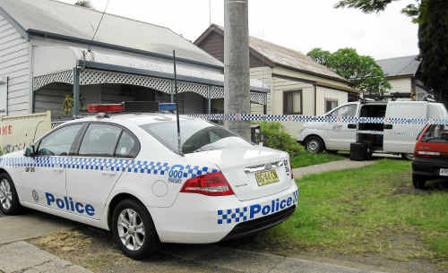 Police around a property in South Grafton.