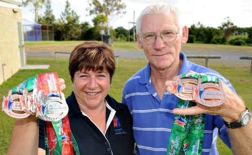 Gympie masters athletes Chris Lucas and Karel McClintock bask in glory after winning medals at the Pan Pacific Games on the Gold Coast last weekend.