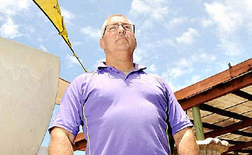 Chris Hobson inspects the damage caused to his Buderim business.