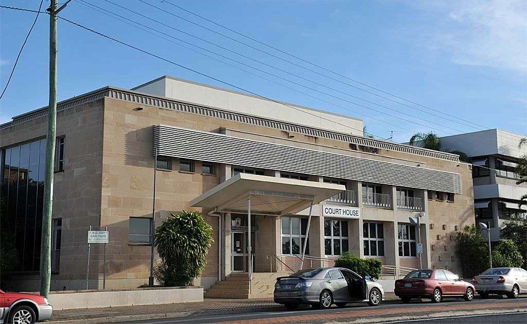 A Magistrate says a Childers man who spat blood and saliva on three police officers as they tried to arrest him for breaching bail was set up to fail.