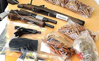 Guns seized during drug raids as part of Operation Ice Bobcat.
