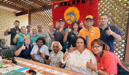 Kalang Respite Care Centre manager Del Howden (front right) with staff and elders, giving the thumbs-up to a $1.8 million grant.