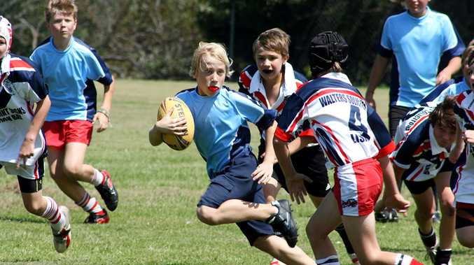 Action from the Byron Bay Public School and St Finbarr's Primary Schools rugby league match last week.