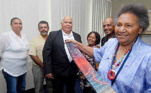 Ceremonial sashes are presented to a group of elders and respected persons in Mackay yesterday. Among them are, Winnie Boah, front, and from left, Blanche Sutherland, Noel Tass, Arnold Doyle, Maude Corowa and Jeff Timor.
