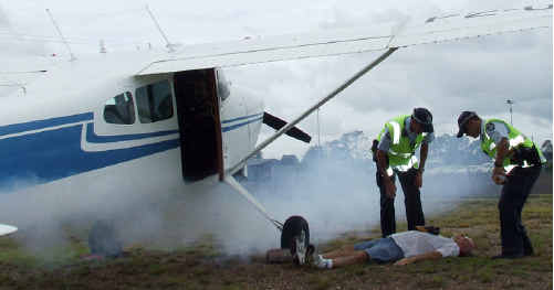 """Smoke billows from a plane that """"crashed"""" on take-off at Maryborough Airport yesterday."""