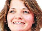 Jessica Watson helps flood victims