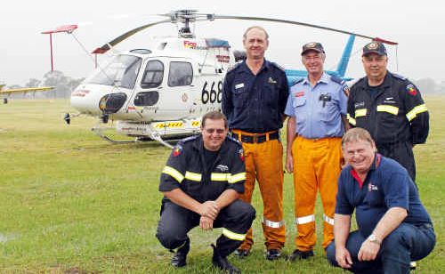 Air attack supervisor Warren Buckley, deputy group officer for Warwick Mal Stacey, Warwick Rural Fire Brigades group officer Alan Payne, air observer Wayne Ford and QFRS manager of air operations Inspector Wayne Bates.