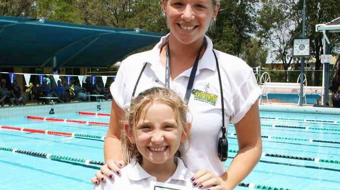 Piper O'Grady with swimming coach Haylee Reddaway. Piper broke a 12-year record in butterfly.