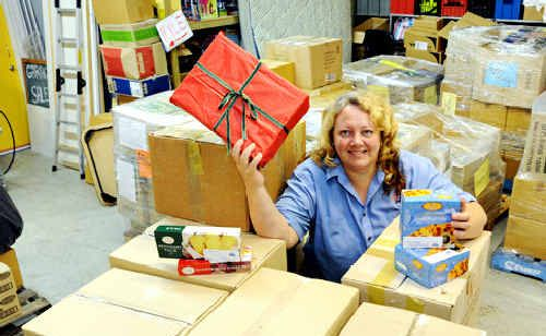 Melissa Close from Care Outreach with packages to be sent to needy families.