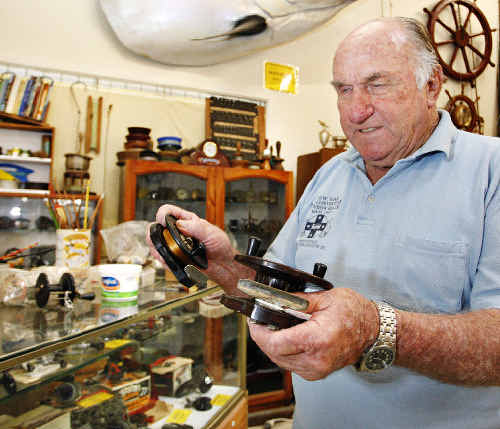 Keith Alcorn, of Evans Head, with his own four- and five-inch Steelite centre pin reels that he bought back in 1948. Part of his extensive collection was acquired from the former National Fishing Museum in Melbourne.