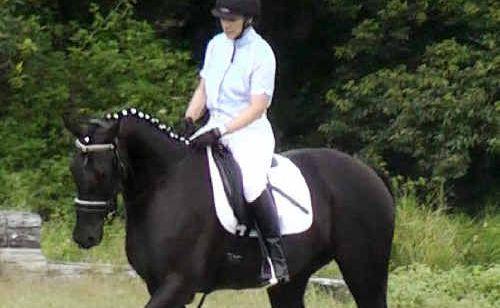 Naomi Gallaway rides her pony 'Baby'.