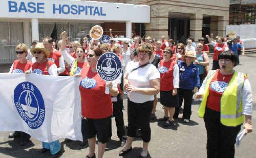 Nurses in the region will take industrial action tomorrow to force the State Government to introduce minimum nurse-to-patient ratios. Nurses are pictured protesting outside Lismore Base Hospital last year.