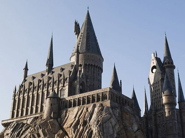 The magnificence of Hogwarts castle above Hogsmeade at The Wizarding World of Harry Potter in Florida.