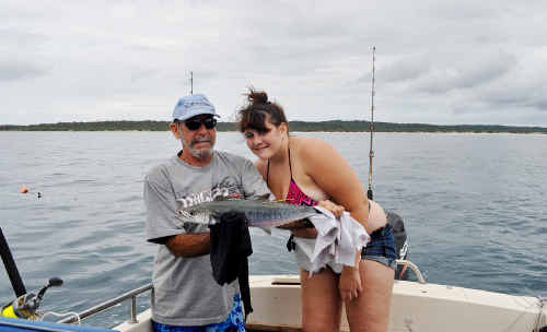 Jessica Rosman with a small Spanish mackerel tagged and released inside Fraser Island.