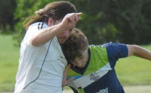 Magpies player Heath Payton, left, competes for the ball with Young Miners player Warrick Jansen.