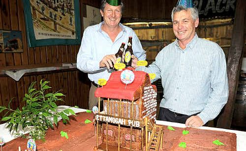 Ettamogah pub general manager David Thompson, left, and pub manager Peter Raymond cut the replica birthday cake at the birthday celebrations.