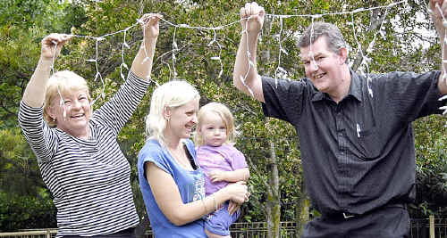 Preparing for the 2010 Chronicle Christmas Lights competition are (from left) co-ordinator Kay Pimm, Alena Oliver-Nicholls and daughter Sienna Nicholls with McDonalds representative Jerry McWilliam.