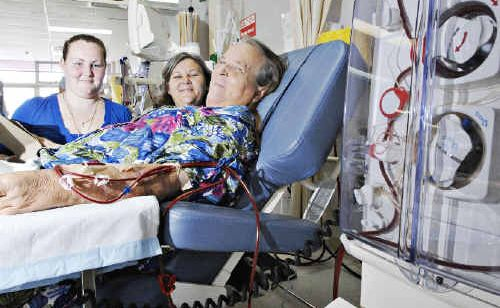Dawn Johnston undergoes another five-hour treatment on a dialysis machine in the renal unit at Lismore Base Hospital, watched by grand-daughter, Alice Dwyer, 15, and daughter Bronwyn Dwyer.