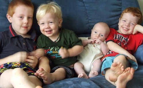 Joanna Evans had two of her sons, Jayden 7, left, and Ashley, 4, far right, using private health insurance, but then went public because of economic pressures to have Kyan, 2, and Leo, 9 months.