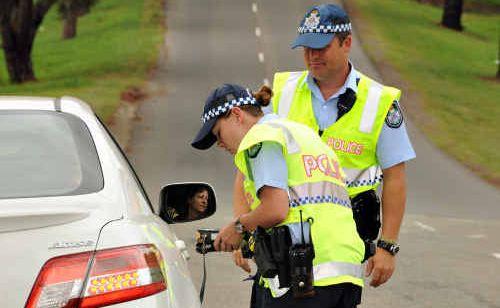 Constables Simone Shearer and Craig Woodman random breath test a driver on Duke Street.