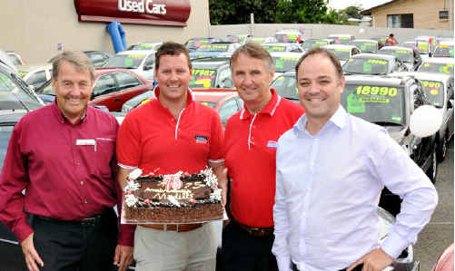 John Madill, John Scott Madill, Garth Madill and Madill's general manager Steve Thorn celebrate 75 years in car sales and service.