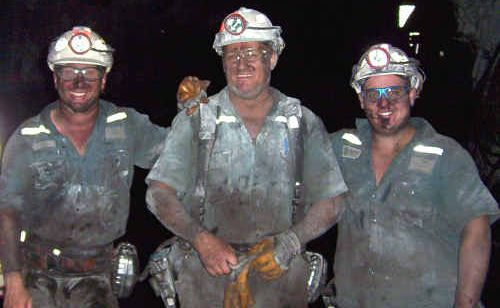 Miners from Moranbah North coal mine, left, Joe Martorana and Jason Pietzner, right, remember workmate William Joynson (centre) who is presumed dead after the Pike River mine explosion in New Zealand.