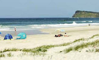 Rescue: Lennox Head beach near where Brian Dell saved the lives of two tourists who had fallen off rocks.