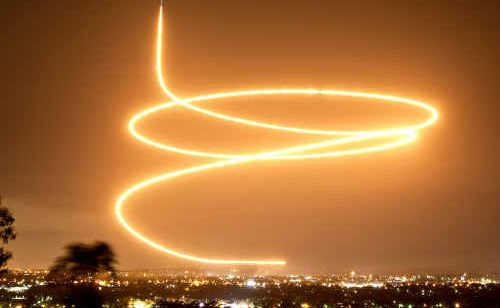 Phil Rettke's time exposure photo of the final F-111 dump-and-burn over Bundamba on Saturday night.