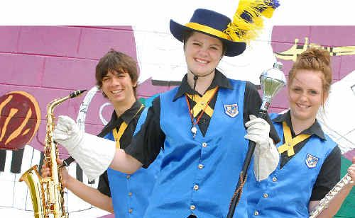 Mackay North State High School students, from left, Mark Gordon, Rebecca Barbi and Emily Atkins, who will be in Year 12 next year, will travel to China with the school's marching band to perform at the Shanghai Tourism Festival.