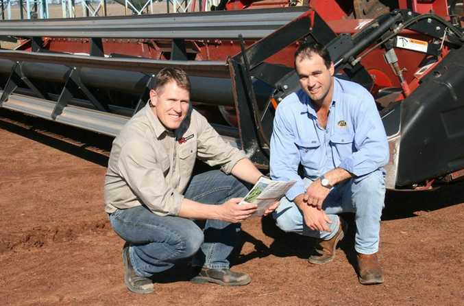 Competition sponsor Rob Anderson (left) from B and L Seed and Grain congratulates Australian Mungbean Association Production Excellence Award winner Justin Commens, from Dalby.